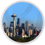 Buildings In A City With Mountains Round Beach Towel