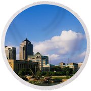 Buildings On The Banks Of A River Round Beach Towel