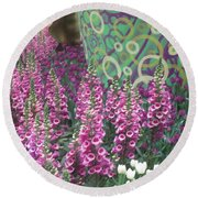 Round Beach Towel featuring the photograph Butterfly Garden Purple White Flowers Painted Wall by Navin Joshi