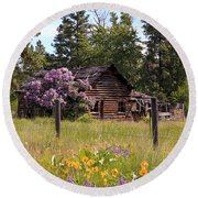 Round Beach Towel featuring the photograph Cabin And Wildflowers by Athena Mckinzie