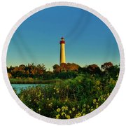 Cape May Lighthouse Above The Flowers Round Beach Towel