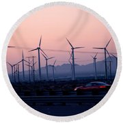 Car Moving On A Road With Wind Turbines Round Beach Towel