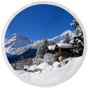 Chalets In A Snow White Valley Round Beach Towel by IPics Photography
