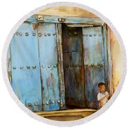 Child Sitting In Old Zanzibar Doorway Round Beach Towel by Sher Nasser