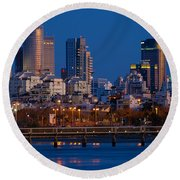 city lights and blue hour at Tel Aviv Round Beach Towel