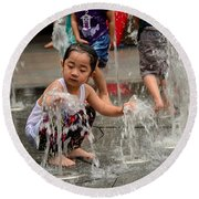 Clothed Children Play At Water Fountain Round Beach Towel