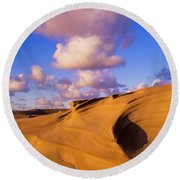 Clouds And Dunes Are Shape-shifters Round Beach Towel
