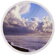 Clouds And Tide Moving Onto The Shore Round Beach Towel