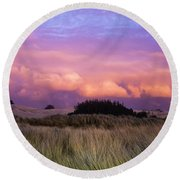 Clouds Catch Light From The Setting Sun Round Beach Towel