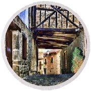 Cobble Streets Of Potes Spain By Diana Sainz Round Beach Towel