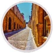 Rhodes Cobbled Street Round Beach Towel by Scott Carruthers