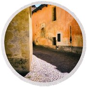 Round Beach Towel featuring the photograph Cobbled Street by Silvia Ganora