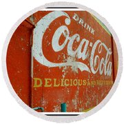 Round Beach Towel featuring the photograph Coca-cola On The Army Store Wall by Kathy Barney
