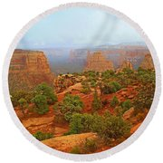 Colorado Natl Monument Snow Coming Down The Canyon Round Beach Towel