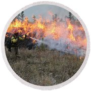 Cooling Down The Norbeck Prescribed Fire. Round Beach Towel