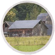 Round Beach Towel featuring the painting Country Art - Rustic Old Barns With Cow In The Pasture by Jordan Blackstone