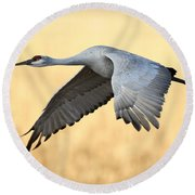 Crane Over Golden Field Round Beach Towel