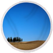 Cypress Forest In The Barren Rolling Hills Of Tuscany Round Beach Towel by IPics Photography
