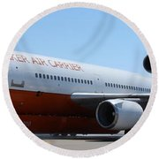 Round Beach Towel featuring the photograph Dc-10 Air Tanker At Rapid City by Bill Gabbert