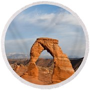 Delicate Arch At Sunset Round Beach Towel by Jeff Goulden