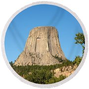 Devils Tower Round Beach Towel by John M Bailey