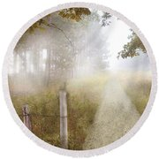 Dirt Road In Fog Round Beach Towel