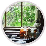 Round Beach Towel featuring the photograph Doctor - Medicine And Hurricane Lamp by Susan Savad