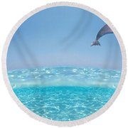Dolphins Leaping In Air Round Beach Towel