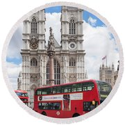Double-decker Buses Passing Round Beach Towel by Panoramic Images
