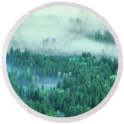 Elevated View Of Fog Over A Forest Round Beach Towel