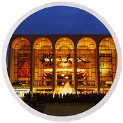 Round Beach Towel featuring the photograph Entertainment Building Lit Up At Night by Panoramic Images