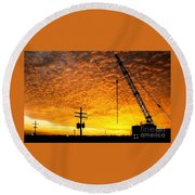 Erecting A Sunset In Beaumont Texas Round Beach Towel