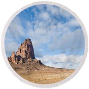 Evening Light On Agathla Peak Round Beach Towel