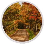 Fall Color Along A Dirt Backroad Round Beach Towel by Jeff Folger
