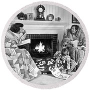 Family Huddled By Fireplace Round Beach Towel