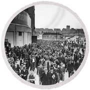 Fans Leaving Yankee Stadium. Round Beach Towel by Underwood Archives