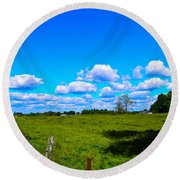 Fence Row And Clouds Round Beach Towel by Nick Kirby