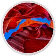 Fire Beneath The Sky In Antelope Canyon Round Beach Towel by Greg Norrell