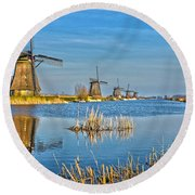 Round Beach Towel featuring the photograph Five Windmills At Kinderdijk by Frans Blok