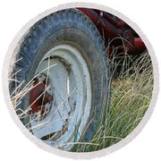 Round Beach Towel featuring the photograph Ford Tractor Tire by Jennifer Ancker