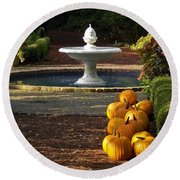 Round Beach Towel featuring the photograph Fountain And Pumpkins At The Elizabethan Gardens by Greg Reed