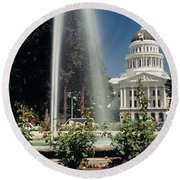 Fountain In A Garden In Front Round Beach Towel by Panoramic Images