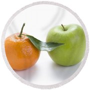 Round Beach Towel featuring the photograph Fresh Apple And Orange On White by Lee Avison