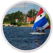 Gentle Sails And Little Traverse Lighthouse Round Beach Towel