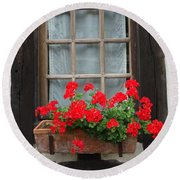 Geraniums In Timber Window Round Beach Towel
