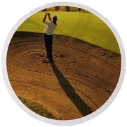 Golfer Taking A Swing From A Golf Bunker Round Beach Towel