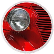 Headlight On Red Car Round Beach Towel by Ludwig Keck