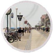 Heat Waves Make The Boardwalk Shimmer In The Distance Round Beach Towel