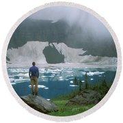 Hiker Beside Iceberg Lake.  Glacier Round Beach Towel