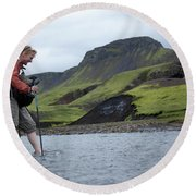 Hiker Crossing A River Round Beach Towel